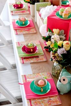 cupcakes, notebooks, flowers and presents make up this tea party inspired table