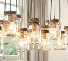 MASON JARS: So many great ways to use them. Here's some ideas for mason jar lights, mason jars in decor, mason jar storage. Lamp, Mason Jar Chandelier, Mason Jar Pendant Light, Mason Jar Diy, Light Fixtures, Lights, Jar Chandelier, Mason Jar Light Fixture, Mason Jars