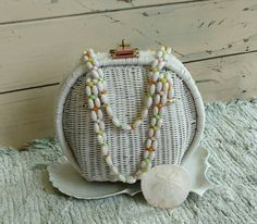 Check out this item in my Etsy shop https://www.etsy.com/listing/386212190/vintage-white-wicker-purse-with-beaded