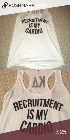 Kappa delta. Kd. Tank top Kappa delta. Kd. Sorority. muscle tee tank top v neck tight top. Racer back tank. Never worn.  . Purchased for recruitment spirit week but never wore it.  Says KD inbetween your shoulder blades on the racer razor back as you can see in the image Tops Tank Tops