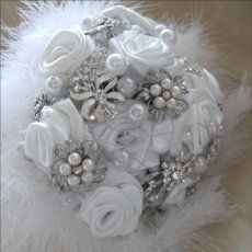 Feathered crystal brooch bouquets with handmade satin roses €175 at www.carolshawjewellery.com