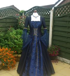 It was of a beautiful material, some sort of taffeta she thought in a deep blue with gold embroidery. It was of an old style, and a little large for her, but still very elegant, and a much nicer change from her servants rags.