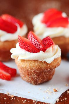 Strawberry Shortcake Doughnut Muffins. These are like little bites of HEAVEN. A muffin that tastes like a doughnut, dunked in brown butter and rolled in cinnamon sugar for a sweet, crunchy crust. Then topped with buttercream frosting and fresh cut strawberries. Amazing.