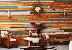 Funky reclaimed wood wall.  This would be fun on a patio wall. (created by designer Sarah Reiss)