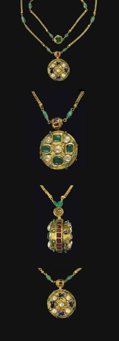 A BYZANTINE GOLD, SAPPHIRE, EMERALD, GARNET AND PEARL PENDANT ON A GOLD AND…