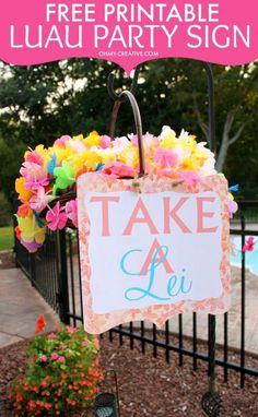 "Hawaiian Luau Parties are always fun especially in the summer when you can bring a little bit of paradise to the backyard! The decorations are vibrant and colorful. Here is a FREE PRINTABLE ""TAKE A LEI"" SIGN so guests can help themselves to a lei - a great party starter and luau decoration! 