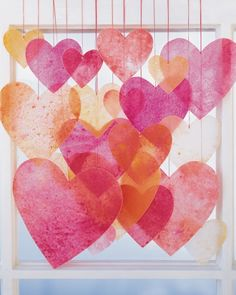 Crayon Hearts: (or any shape or color you want) chandelier- wax paper, wax crayons, hand held sharpener, iron, craft paper, string, scissors,