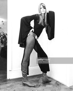 German fashion model Veruschka poses leaning against a wall wearing a thigh-baring black dress and a peacock feather over one eye, London, October 14, 1971. The six-foot-one inch daughter of a German count is the world's most expensive model, earning as much as 1000 pounds for a day's work.