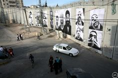 French street artists JR and Marco constructed this large, illegal public exhibition they called Face 2 Face on both sides of conflict-stricken Palestine and Israel. The project consisted of taking and posting giant portraits of Palestinian and Israeli citizens on both sides of the wall that separate the cities. The artists' use of something as simple as a humorous portrait to humanize two groups of people who see the other as less than human, makes this  one of my favorite social pieces.