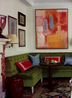 velvet banquette love the line and modern painting!