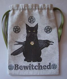 What a great tarot card bag.  I love the kitty, and the pentagrams.  Very cute.