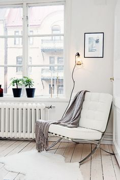 Moden and white chair in corner with industrial floor lamp