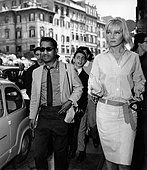 Sammy Davis Jr. walking the streets of Rome with his wife May Britt - Stock Photo