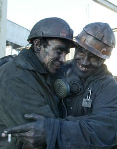Two miners embrace after being rescued from a collapsed mine in the eastern Ukrainian city of Snezhnoye. (2006)