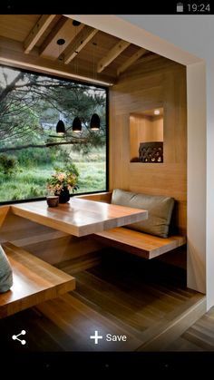 Cosy cubby seat - like the window by the built in seating, although we don't like this specific wood, we like the use of wood and the warmth it gives to spaces like this.