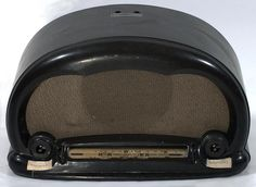 Wireless. Radio - Bakelite, circa 1930. Used in a psychiatric hospital in Beechworth, Victoria, Australia, circa 1930. Two missing control knobs, one for volume and one for station selection, on each lower side of radio. Station selection dial for short wave/interstate radio stations between volume and station knobs. Knobs may have been removed so that patients could not alter settings.  Collection: Museum Victoria