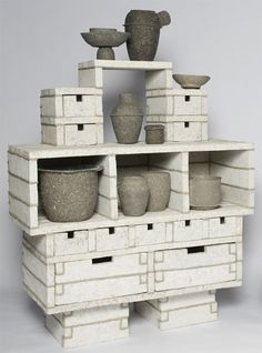 Is a totemic white furniture piece,  constructed from various oblong boxes stacked upon one another | Paperpulp Cabinet by @Debbie Wijskamp | White Cabinet | Modern Cabinet | Cabinet Design | Dining room cabinet | http://buffetsandcabinets.com