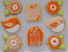Pretty tangerine colored birds and cages