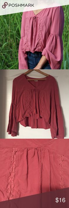 Mauve bell sleeve top V-neck semi cropped top with wide flowing sleeves. Tassels and crochet panels in front. Garage Tops Blouses