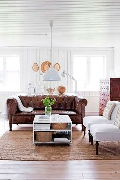my scandinavian home: A beautifully renovated Swedish farmhouse. That brown leather couch. Home Living Room, Living Room Designs, Living Room Decor, Apartment Living, Living Spaces, Farmhouse Interior, Home Interior, Swedish Farmhouse, Modern Farmhouse