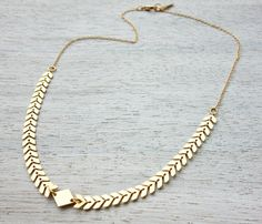 A gorgeous necklace with a dramatic look, made of small geometric chevron shaped elements, linked to a delicate link chain.    Made of high quality