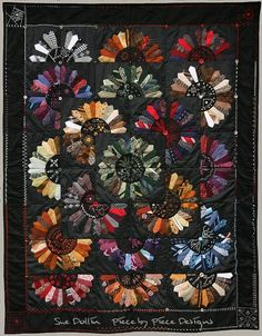 Necktie quilt, Dresden Plate design with embroidered centers, by Sue Dollin. Pattern available.