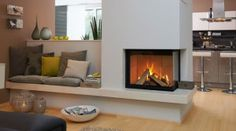 Haus - corner fireplace with sofa next to it and behind the sofa a TV lift so that TV is not in the pictur - Home Fireplace, Modern Fireplace, Living Room With Fireplace, Fireplace Design, Home Living Room, Living Area, Decoration Inspiration, Decoration Design, Room Inspiration