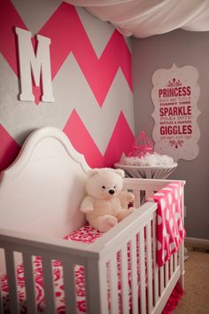 The Frosted Petticoat: Pop of Pink - A monogramed chevron wall frames the little one's crib and all the pops of pink bring the nursery full circle.