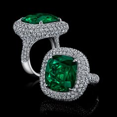 Robert Procop 11ct Cushion Emerald Ring with a Colombian emerald (is a valued source for a very rare, high quality emeralds) decorated with micro pave diamonds, set in platinum.