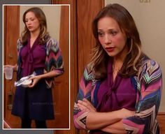 Ann's multi-colored zig-zag/chevron cardigan, magenta blouse and navy skirt on Parks and Recreation