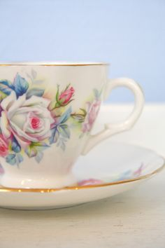 Pink and blue floral on white teacup