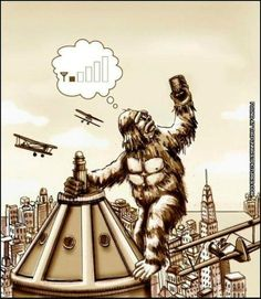 king kong checking cellphone coverage