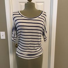 Knit top with navy nautical stripe Easy fitting knit top. Size is XS but fit is closer to a M. Cute slub knit stripes in navy and off white. Tops Tees - Short Sleeve
