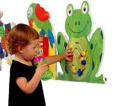 The Frog Wall Panel Activity Toy brings hopping good fun to any wall. This wall mounted toy is great game for waiting rooms or any place where kids gather and play. If you need children to keep occupi Activity Toys, Activities, Daycare Rooms, Church Nursery, Toy Rooms, Waiting Rooms, Waiting Area, Indoor Playground, Kids Church