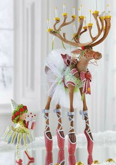 Add a whimsical touch to your Christmas display with the Patience Brewster Dancer Dash Away Reindeer Character