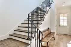 Wrought Iron Stair Railing Staircase Transitional with Baseboards Entrance Entry Metal Railing Rustic Wood