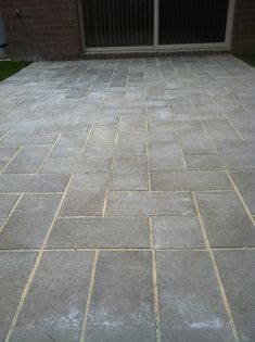 www.pavingcanberra.com  Paving: Courtyard Synthetic Turf and Paving. Paving Product: Havens Slab 400 x 200 x 40mm. Paving Design: 90 degree Herringbone with header. Synthetic Lawn: 3 blend Astro Turf. Paving Edging: Paver head-to-head.