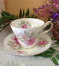 On offer is a Royal Patrician fine bone china teacup and saucer made in Staffordshire, England. This  set is in good condition no chips or cracks and clean inside.  The pink roses and daisies are accented by gold tone trim on rims and handles.  Birdcagevintagefinds on Etsy