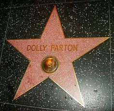 A Vision of DOLLY Parton's Name in Lights reflecting off the cars _____________________________ Reposted by Dr. Veronica Lee, DNP (Depew/Buffalo, NY, US)