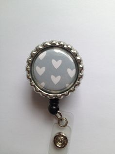 SO FLIPPING CUTE! Retractable Badge Reel. $8.00, via Etsy seller Tiffani DuPaul @ yellowchickdesigns. Great service too!