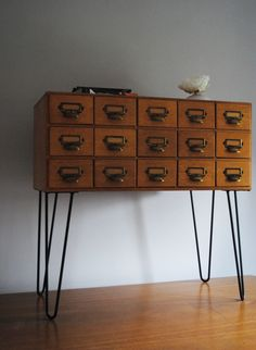 Library cabinet with steel hairpin legs