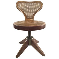 Striking Caned Swivel Chair on Splayed Legs | From a unique collection of antique and modern swivel chairs at https://www.1stdibs.com/furniture/seating/swivel-chairs/
