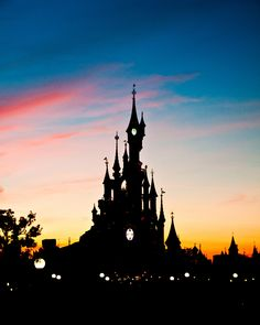 The centre piece of Disneyland Paris, Cinderella's castle, against the French sunset.
