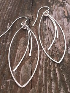 Check out this item in my Etsy shop https://www.etsy.com/listing/160347679/silver-oval-dangle-handmade-earrings