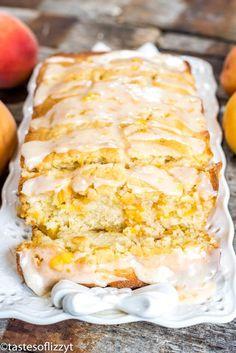 This Peach Bread is a wonderful recipe to incorporate summer peaches. Delicious,… This Peach Bread is a wonderful recipe to incorporate summer peaches. Delicious, moist quick bread full of ripe diced peaches with a easy peach glaze. Peach Quick Bread, Peach Bread, Peach Zucchini Bread, Köstliche Desserts, Delicious Desserts, Dessert Recipes, Easter Recipes, Fruit Bread, Dessert Bread