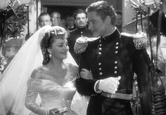 Wedding scene from the movie, They Died with Their Boots On (1942) starring  Errol Flynn and Olivia de Havilland.  Source: Phyllis Loves Classic Movies: Cinema Weddings