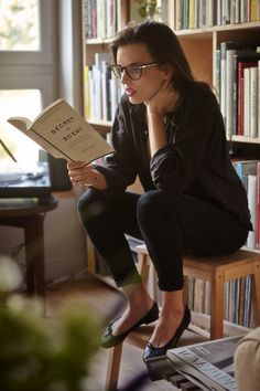 all black outfit, loose black long-sleeved blouse, black-rimmed glasses, black ballet tops, tight black pants - super chic and classic