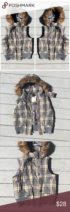 FINAL SALE! Plaid Vest w/ Detachable Fur Hood Excellent condition. The perfect plaid vest! This can be worn open, zipped up or buttoned because it has both! The hood is made with faux fur but is in great condition which comes with elastic draw strings. It also can be detached via buttons. Size Medium. Urban Behavior Brand. Jackets & Coats Vests