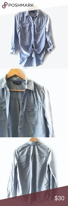 Express Chambray Women's Button Up Women's Express blue chambray button up top.   Size medium   Good condition. All buttons attached. 2 small spots, both shown in photo. May or may not come out with a little work. Express Tops Button Down Shirts