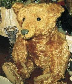 """Stoic look of a 1906 20"""" Steiff cinnamon mohair teddy bear."""